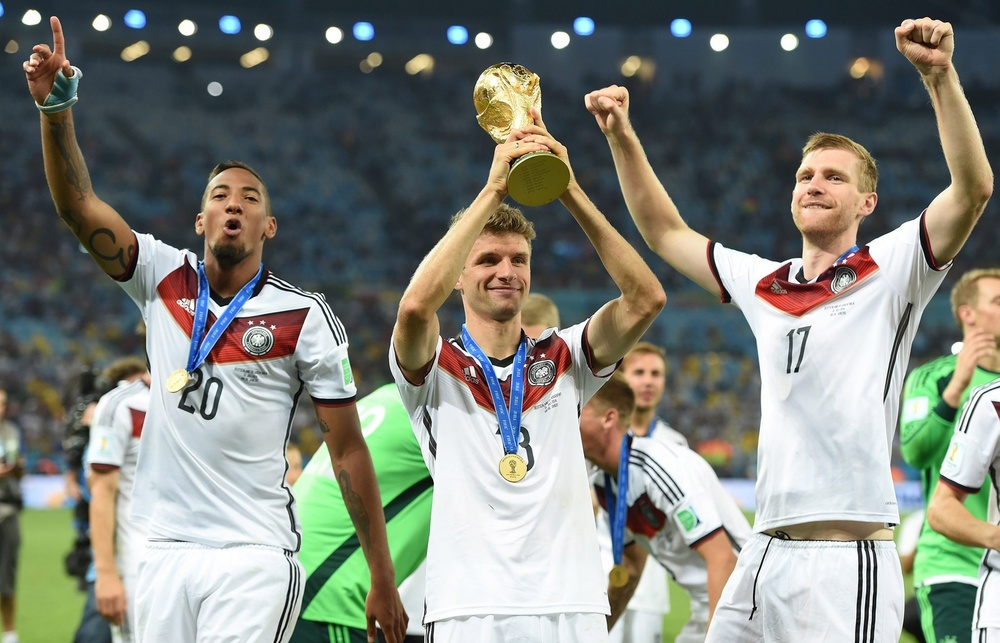 July 13, 2014; Rio de Janeiro, BRAZIL; Germany defender Jerome Boateng (20), midfielder Thomas Muller (13), and defender Per Mertesacker (17) celebrate after winning the championship match of the 2014 World Cup against the Argentina at Maracana Stadium. Germany won 1-0. Mandatory Credit: Tim Groothuis/Witters Sport via USA TODAY Sports