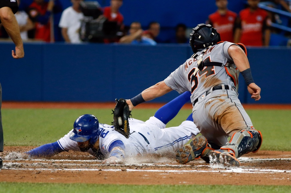 Jul 7, 2016; Toronto, Ontario, CAN; Toronto Blue Jays center fielder Kevin Pillar (11) is tagged out at home plate by Detroit Tigers catcher James McCann (34) in the sixth inning at Rogers Centre. Blue Jays won 5-4. Mandatory Credit: Kevin Sousa-USA TODAY Sports