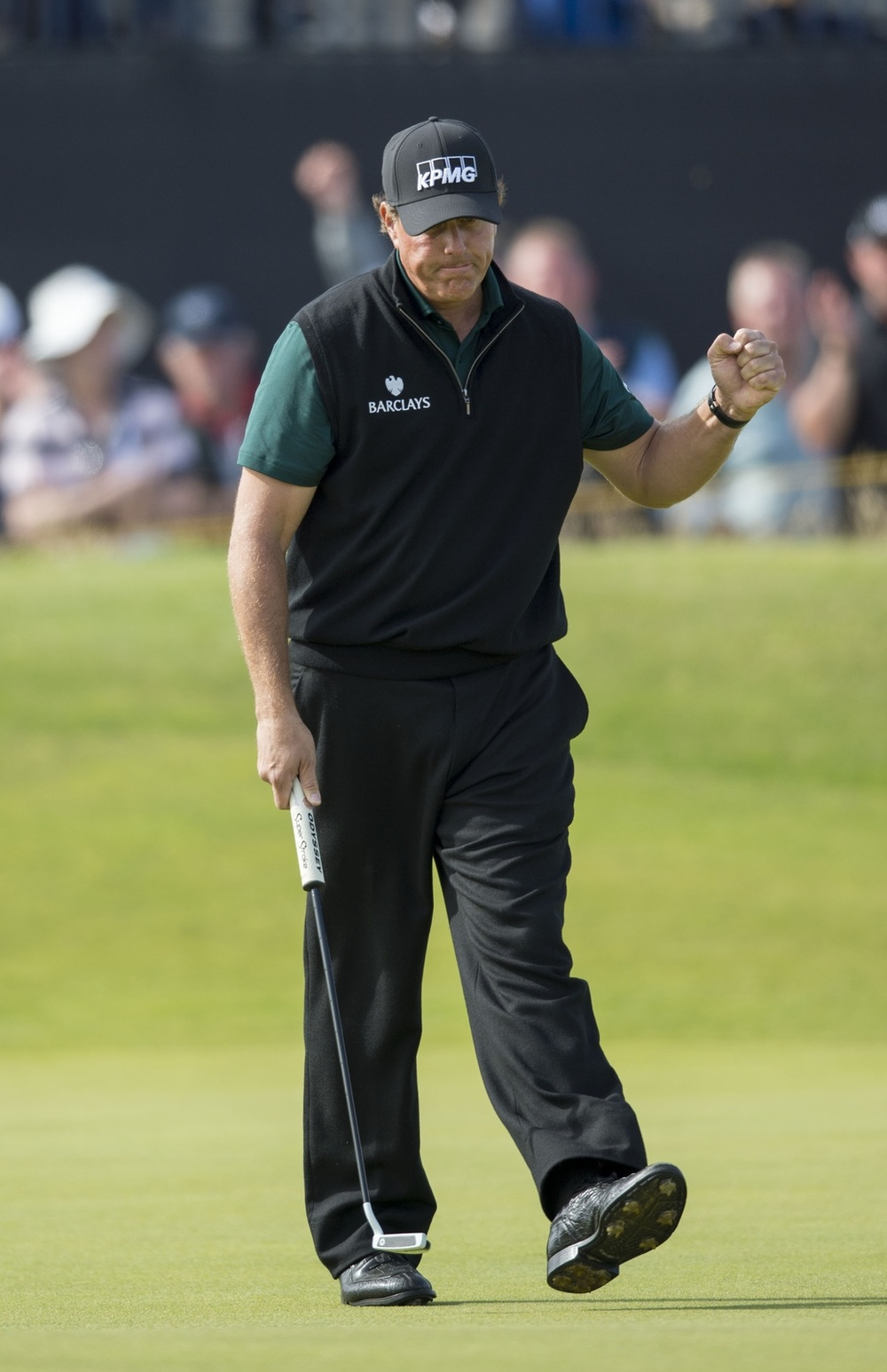 Jul 14, 2016; Troon, Ayrshire, SCT; Phil Mickelson (USA) celebrates after sinking his birdie putt on the par 3 14th during the first round round of the 145th Open Championship golf tournament at Royal Troon Golf Club - Old Course. Mandatory Credit: Ian Rutherford-USA TODAY Sports