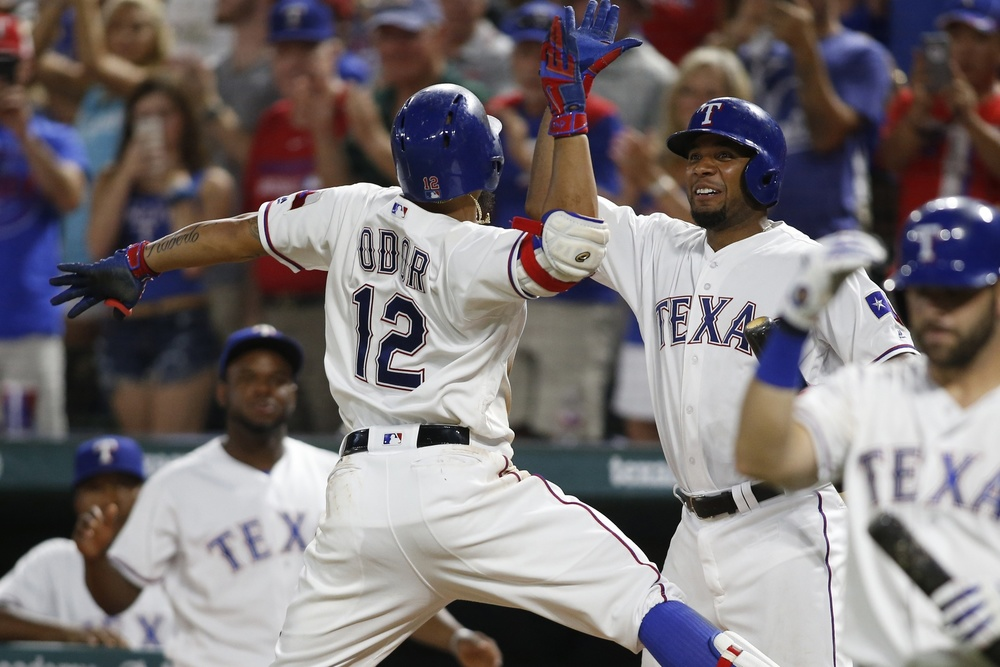 Jul 29, 2016; Arlington, TX, USA; Texas Rangers second baseman Rougned Odor (12) is congratulated by shortstop Elvis Andrus (1) after hitting a home run in the seventh inning against the Kansas City Royals at Globe Life Park in Arlington. Texas won 8-3. Mandatory Credit: Tim Heitman-USA TODAY Sports