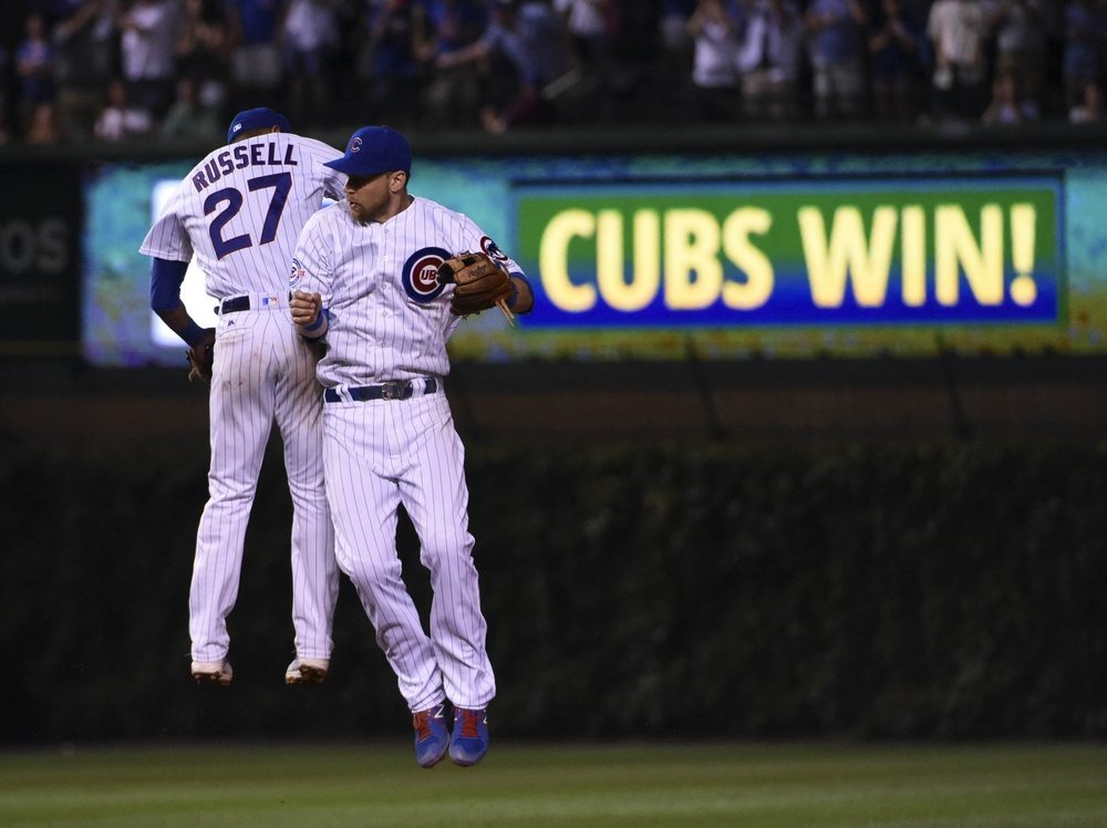 Aug 2, 2016; Chicago, IL, USA; Chicago Cubs shortstop Addison Russell (27) and second baseman Ben Zobrist (18) celebrate their win against the Miami Marlins at Wrigley Field. The Cubs won 3-2. Mandatory Credit: David Banks-USA TODAY Sports