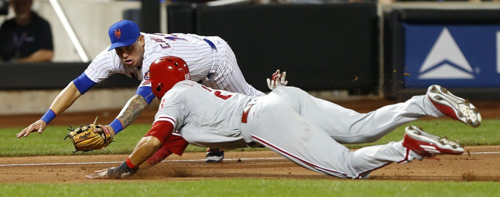 Aug 26, 2016; New York City, NY, USA; New York Mets shortstop Asdrubal Cabrera (13) tags out Philadelphia Phillies right fielder Aaron Altherr (23) at third base in the eighth inning at Citi Field. Mandatory Credit: Noah K. Murray-USA TODAY Sports