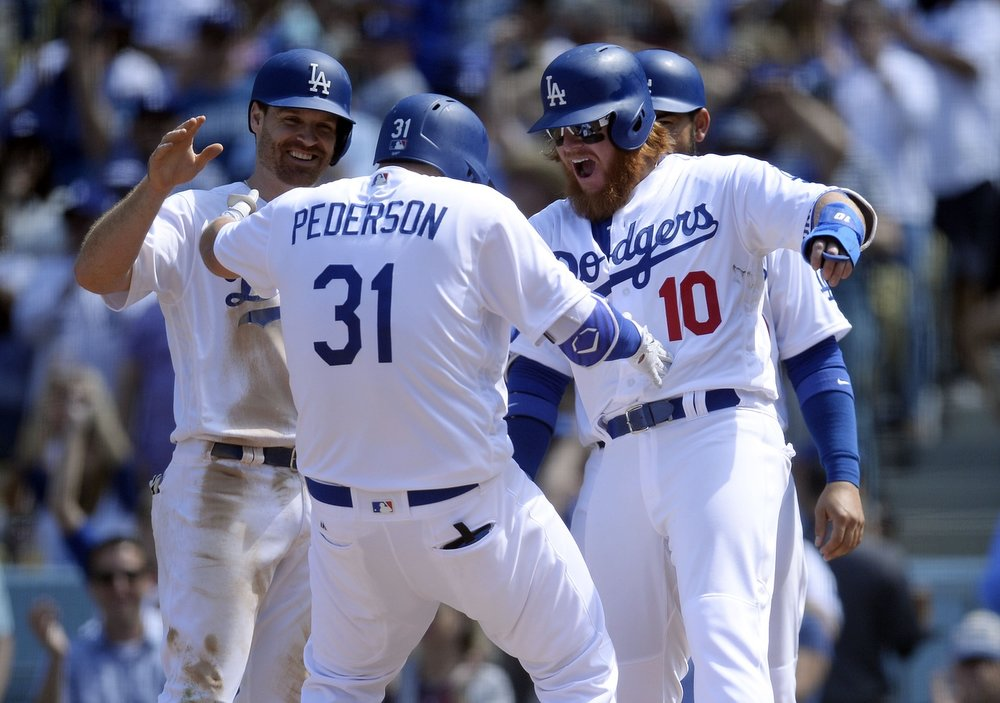 Joc Pederson hits a grand slam and celebrates with Logan Forsythe, Justin Turner, and Adrian Gonzalez.