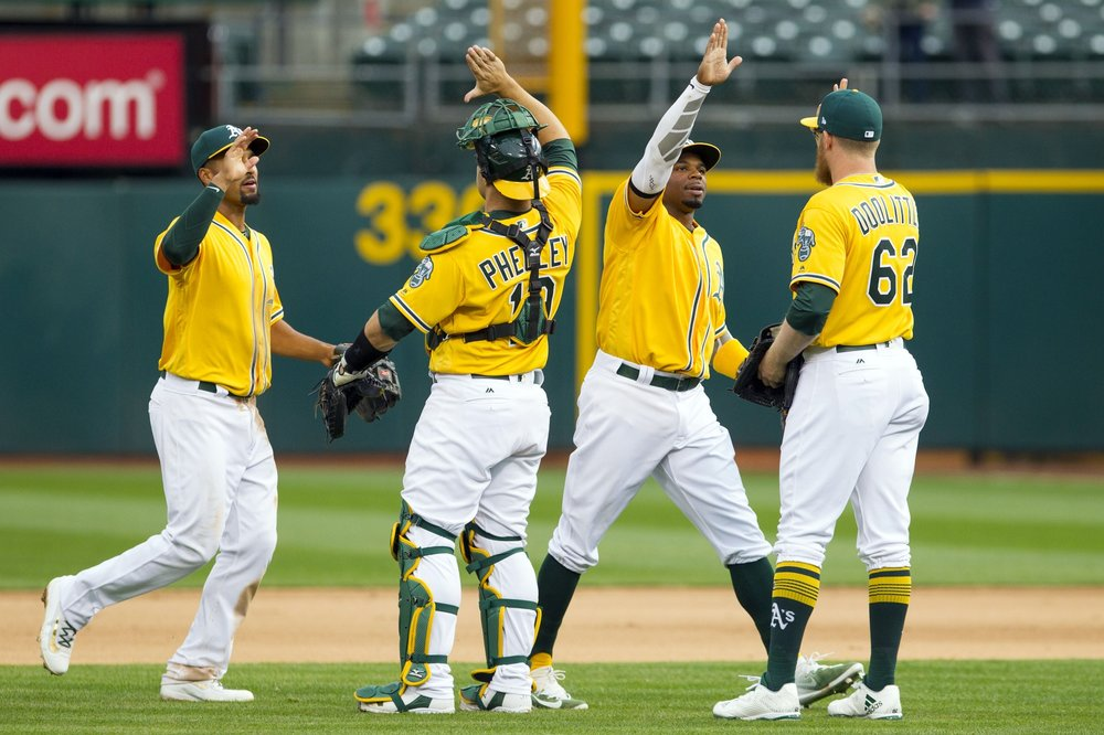 Oakland A's celebrate their win.