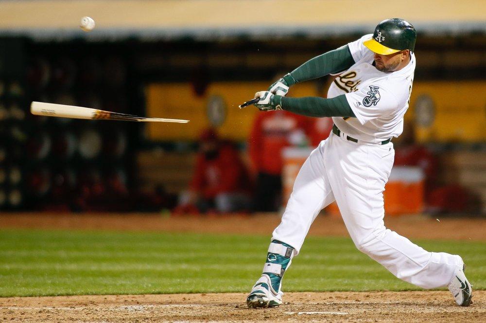 Yonder Alonso breaks his bat.