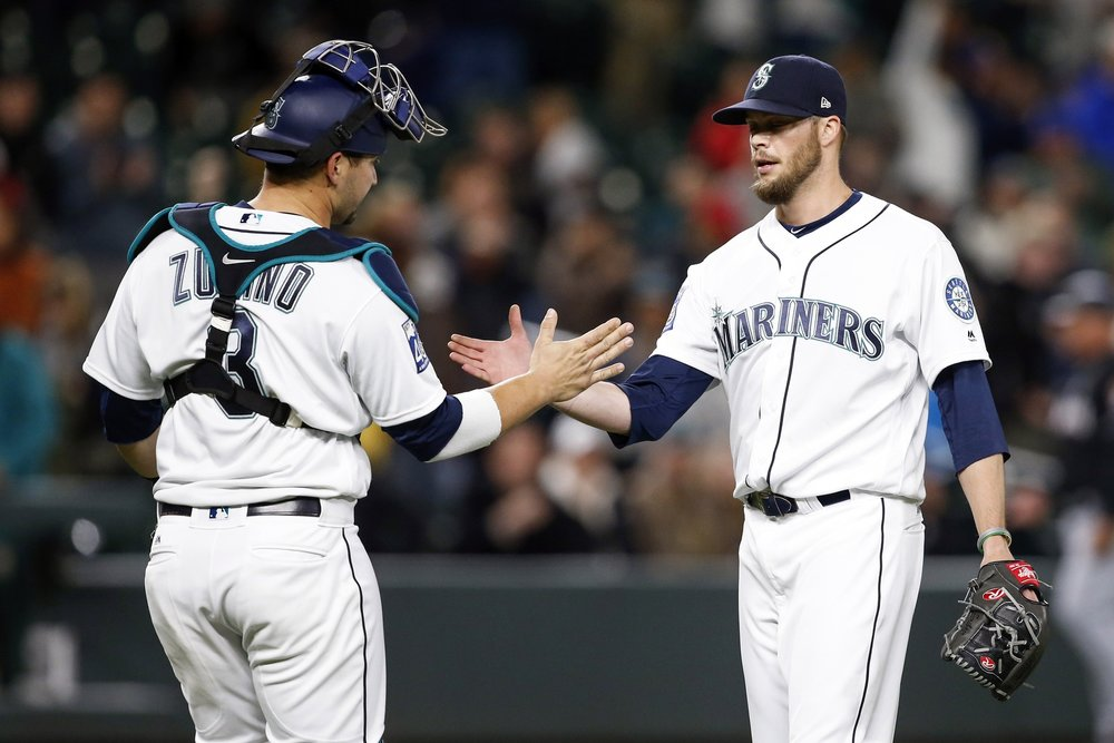 Evan Scribner shakes hands with Mike Zunino after their win.