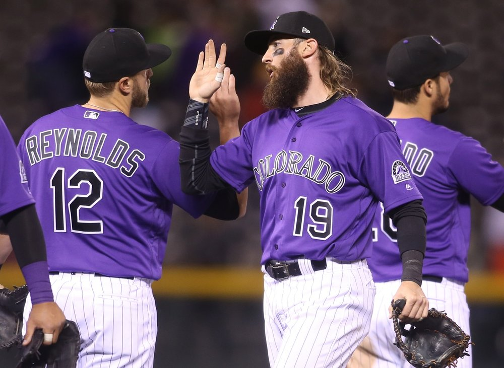 Charlie Blackmon and Mark Reynolds celebrate their win.