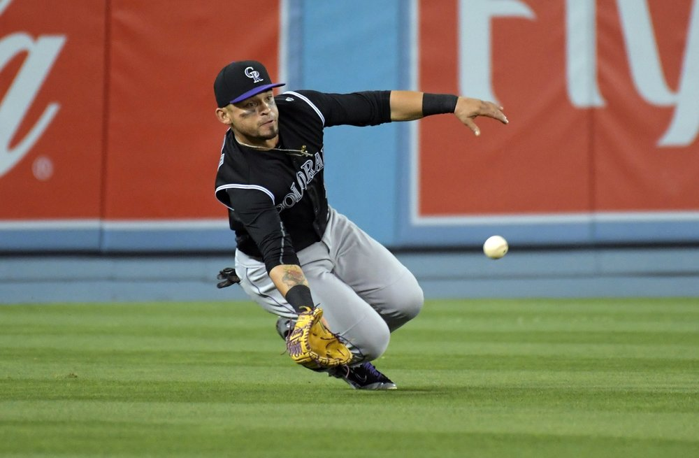 Gerardo Parra dives for the ball.