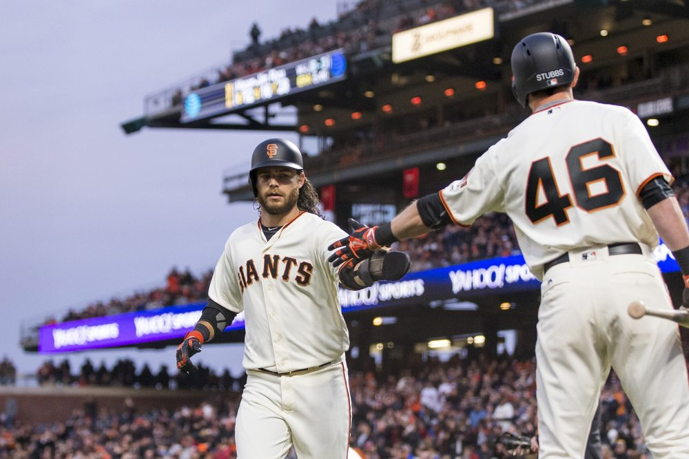 Brandon Crawford and Drew Stubbs celebrate a good play.