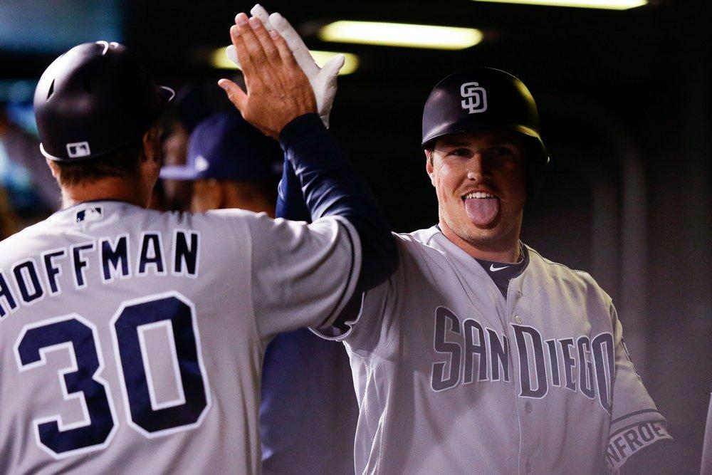 Hunter Renfroe and Glenn Hoffman high five after hitting another home run.