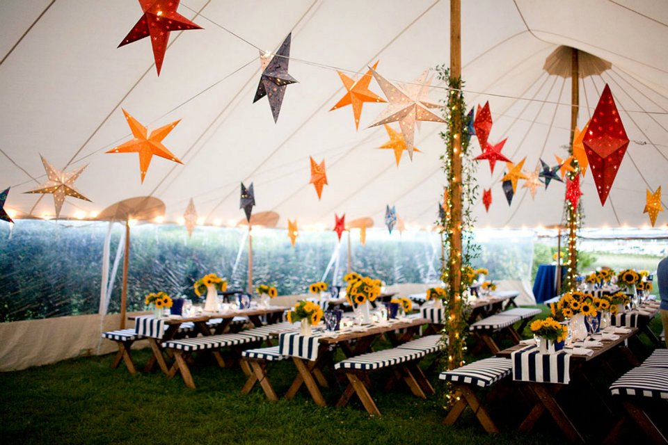 Star lantern installation with cafe lights in a Sperry Tent for a welcome reception on Martha's Vineyard, MA.