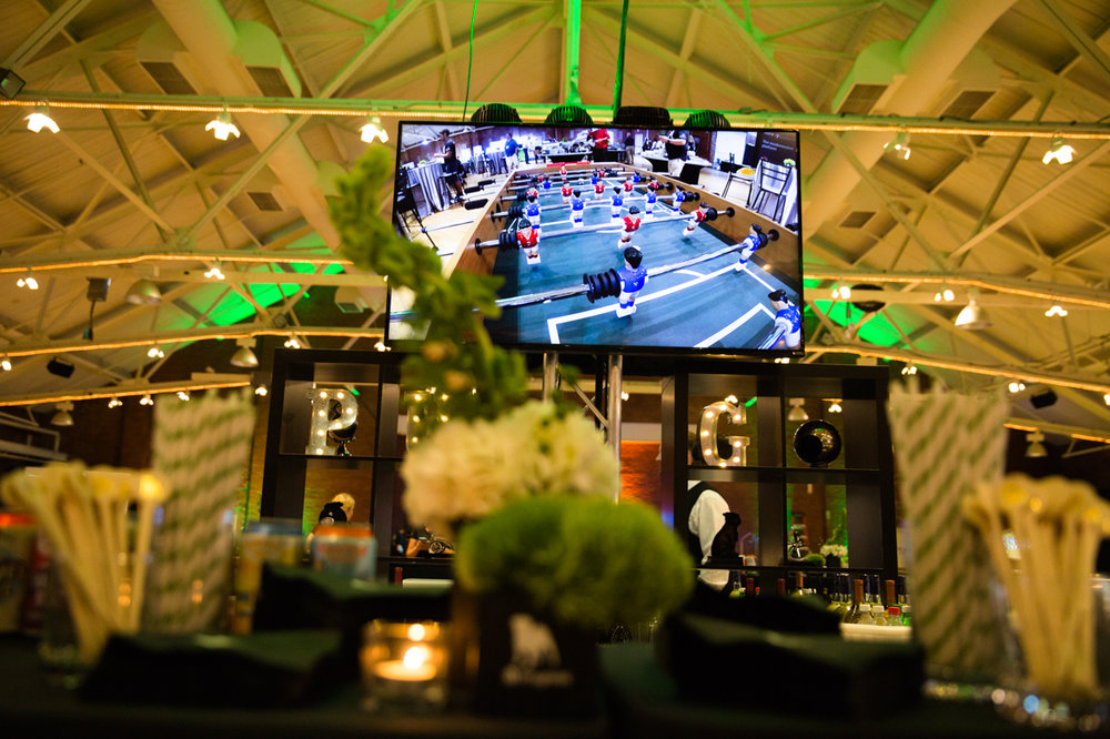 A recent corporate closing party at the Radisson Hotel in Manchester, NH. The live foosball game is featured above. Image by Pizzuti Studios.