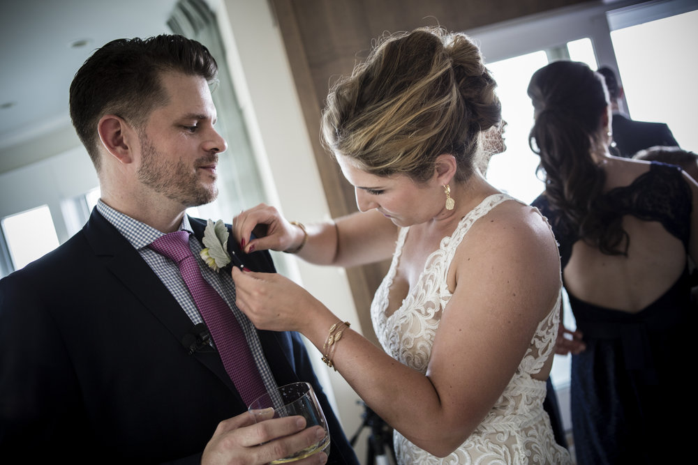 Classic bride reattaching boutonnieres right before she walks down the aisle.