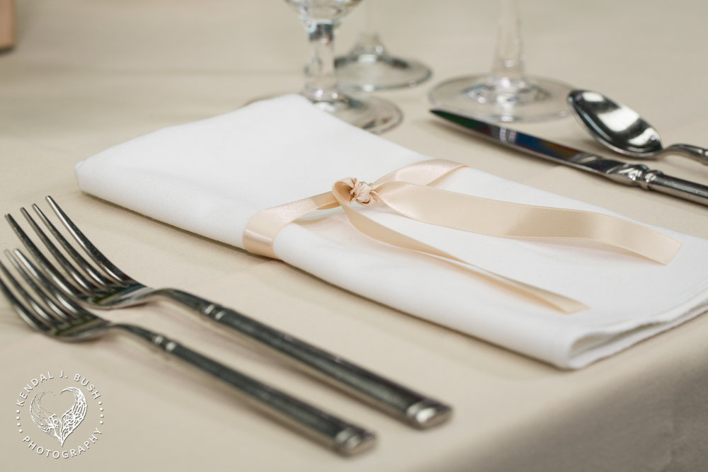 An example of a napkin upgrade, a simple satin ribbon treatment. Image by Kendal J. Bush Photography