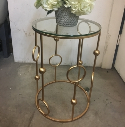 Gold ball accent table with glass top. Available in two sizes.