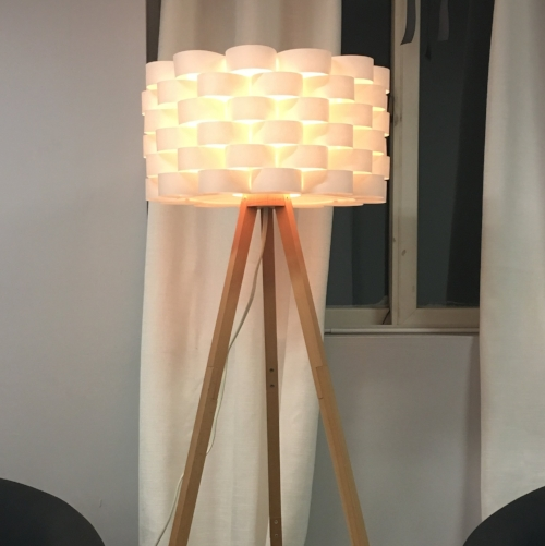 Tripod lamp with white textured shade.