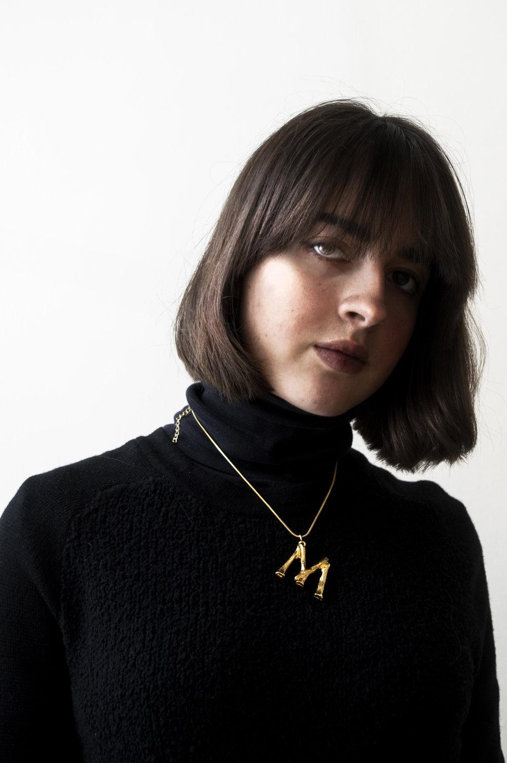 Melissa Wears:    The Céline Alphabet Necklace- Vestiaire Collective