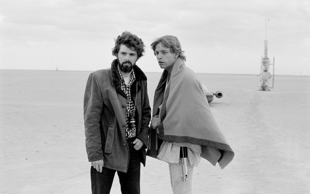 GEORGE LUCAS AND MARK HAMILL ON THE SET OF  STAR WARS  IN TUNISIA, 1976. PHOTO: LUCASFILM LTD