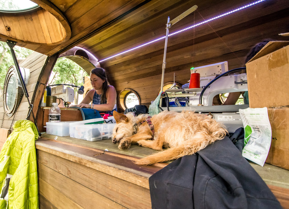Repairing gear is hard work at the Patagonia Worn Wear Wagon