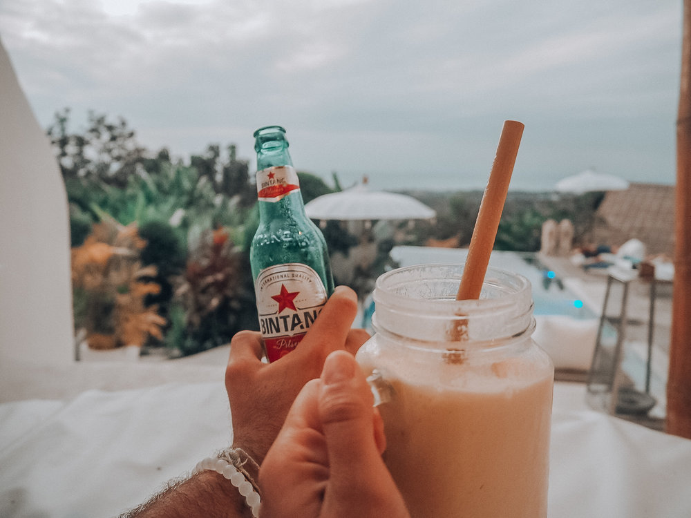 We'll have a bintang and a mango smoothie please.