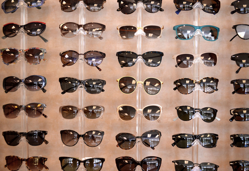 We have a large selection of sunglasses for kids and grown-ups.