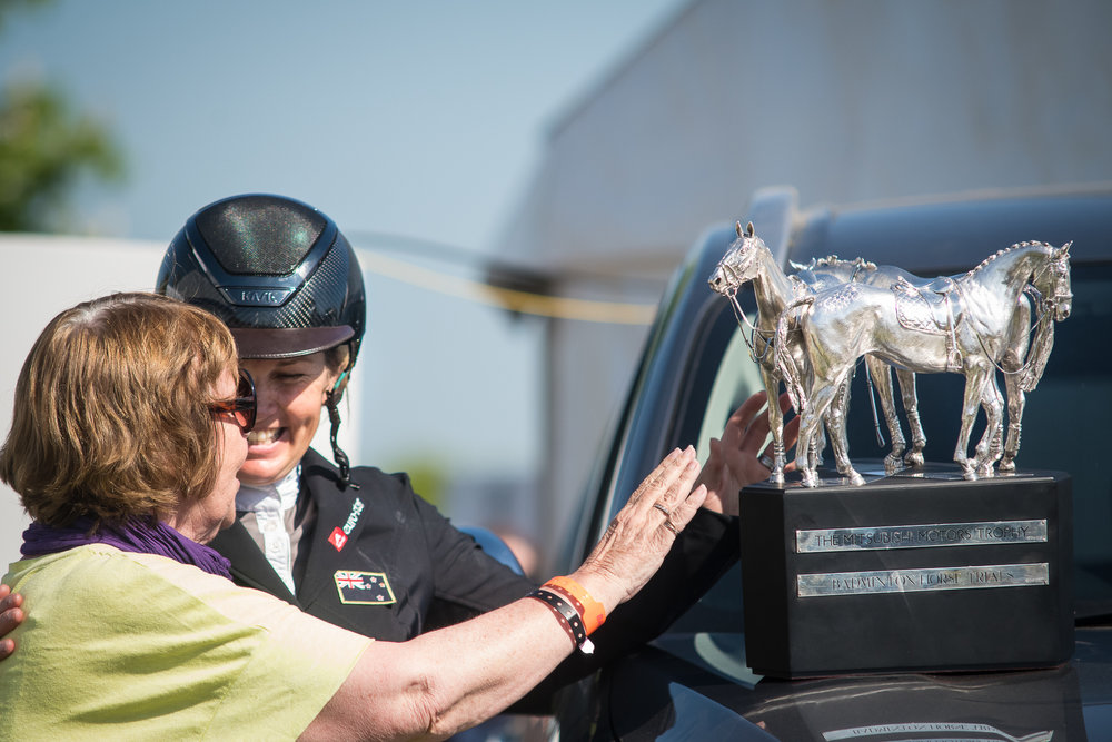 """""""I've finally joined the four-star club"""" - New Zealand's Jonelle Price and owner Trisha Rickard share a special moment as Jonelle takes the Badminton silverware. Photo taken for Eventing Nation."""