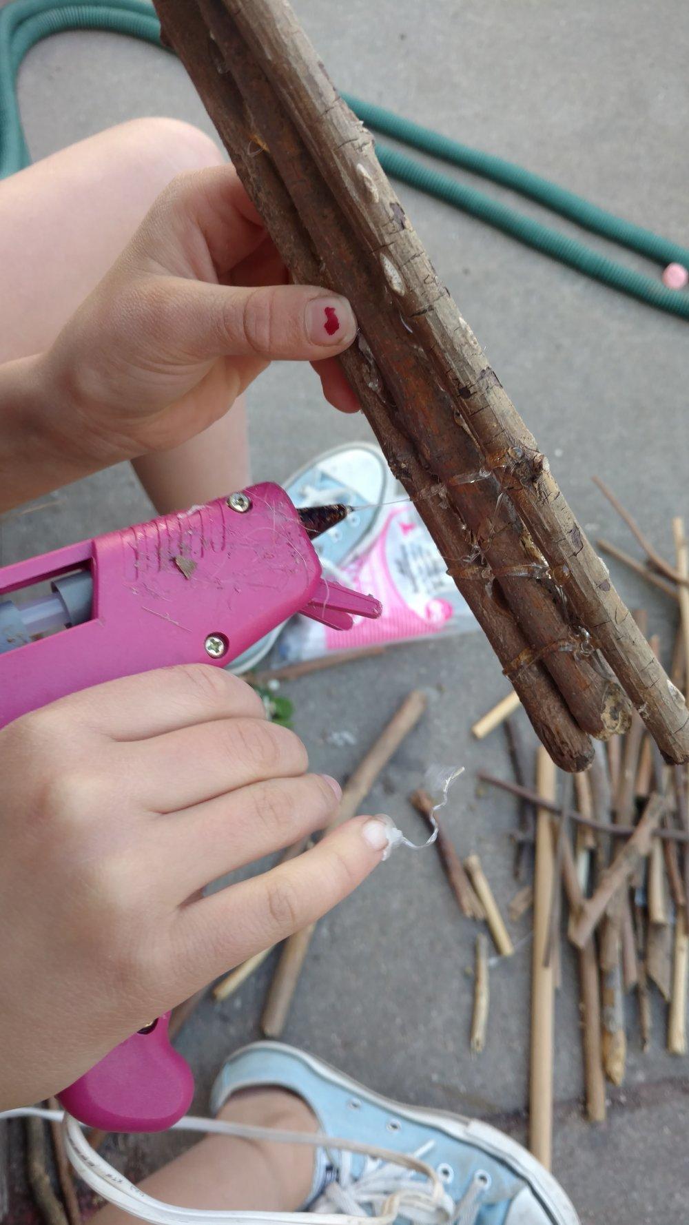 Hot glue gun and sticks.