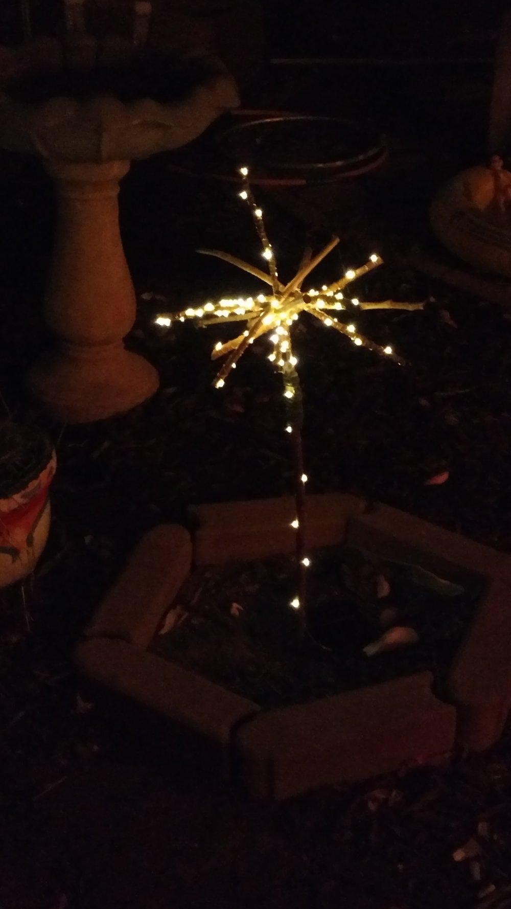Copper string light garden art sculpture.