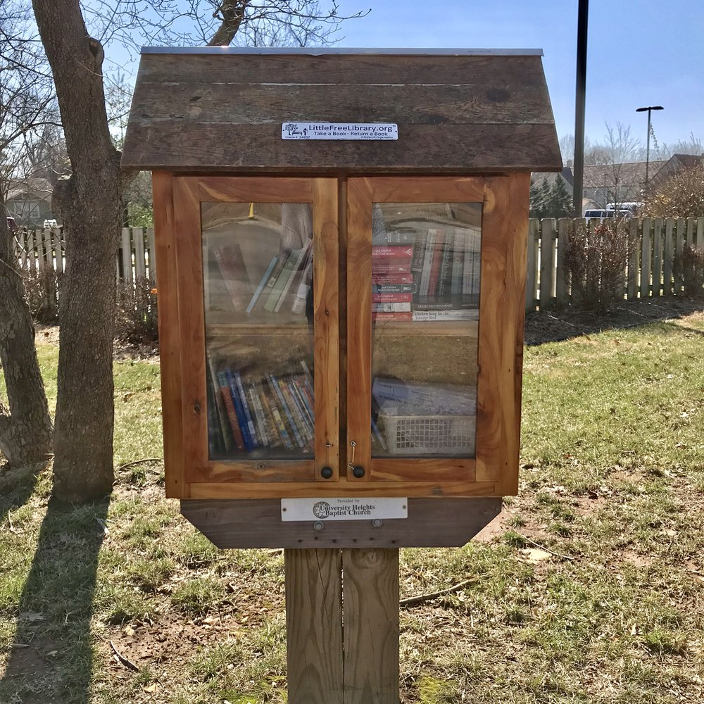 University Heights' Little Free Library on the corner of Grand and Kickapoo