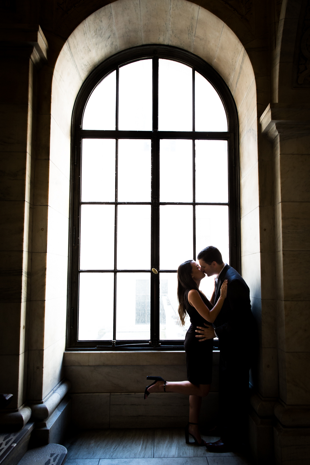 Engagement photo in front of large window