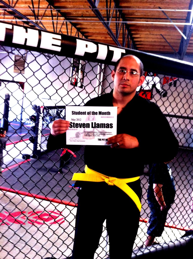 Steven LLamas is one of our hardest workers – always coming to Belt class, Pit Jitsu, and sparring. He has taken his licks but now is starting to dish out some punishment as well. More importantly he is a team player, humble, and a great addition to the Pit family. Steven has just been promoted to yellow belt and is well on his way to his blackbelt at the rate he's going!