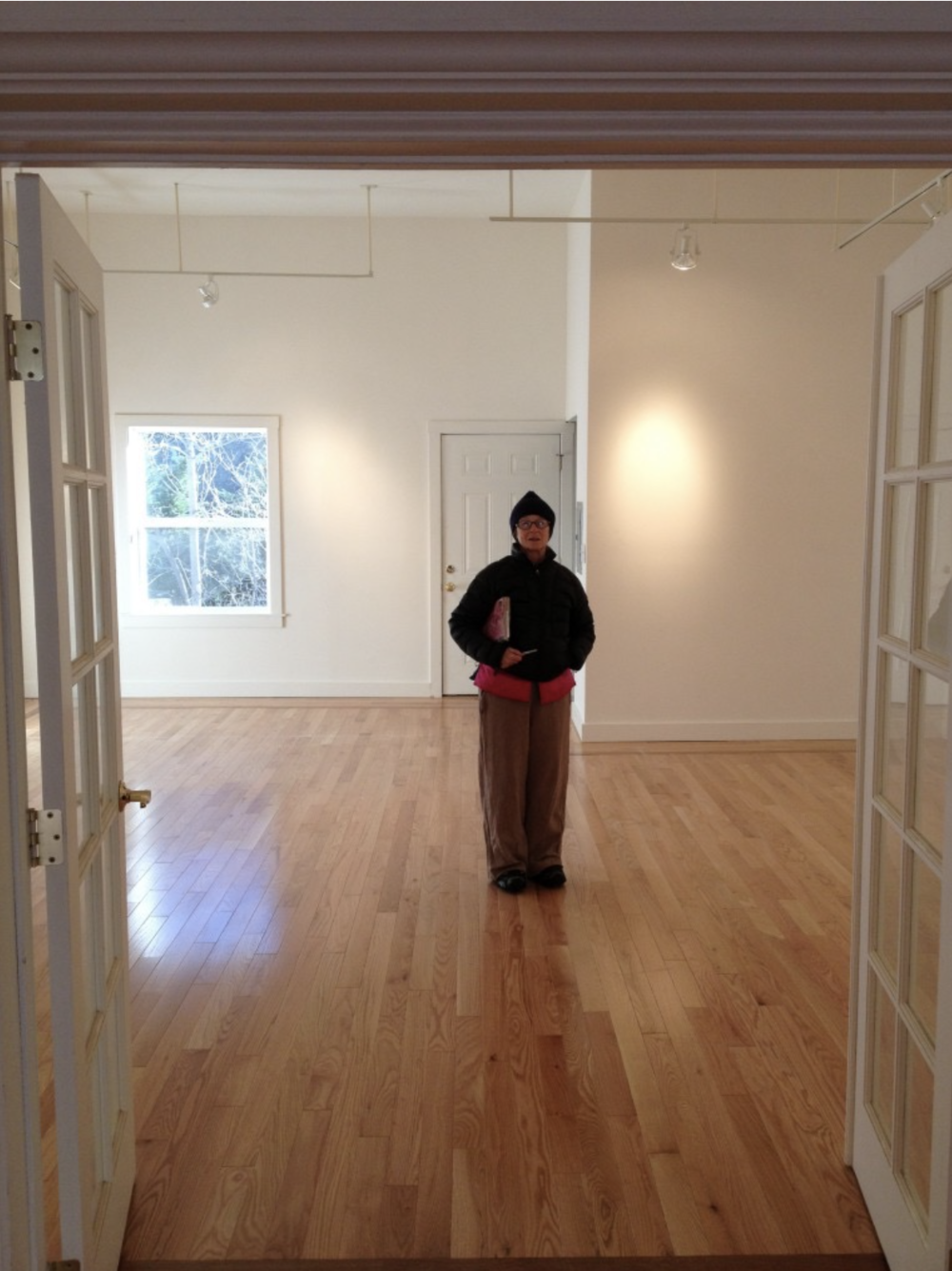 Anne Kinkaid standing in the Siskiyou Arts Museum.