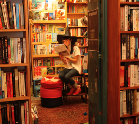 This is me in 2009 at the bookstore I worked at, casting spells on Jodi Picoult and Bridget Jones on Halloween.