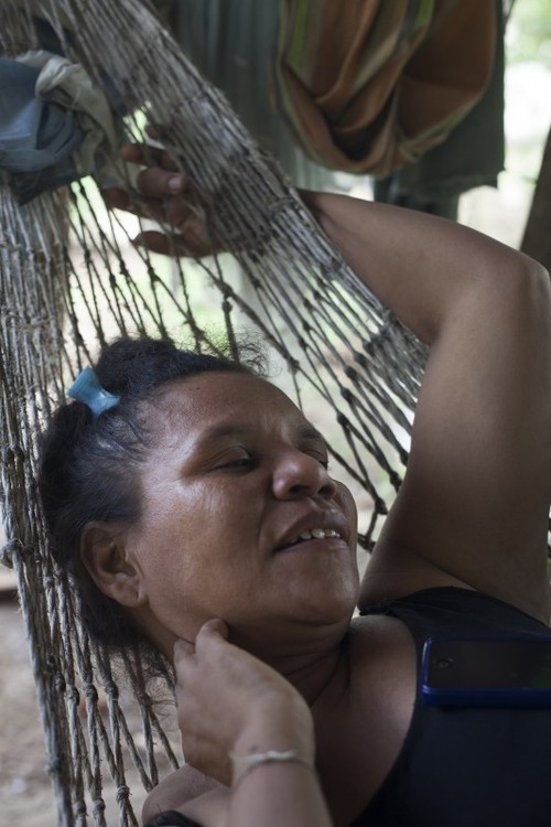 Gavelys in a hammock outside her home in Membrillal, Cartagena. Originally from Atanque, about 7 hours by bus from Cartagena, she arrived in 2006 and settled in Membrillal 9 months post displacement. © Sahara Borja, 2014