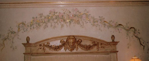 Wood finish on headboard and trim, wall finish and floral design