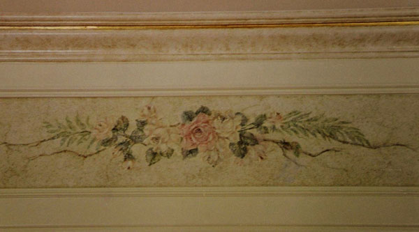 Faux stone finish with floral.