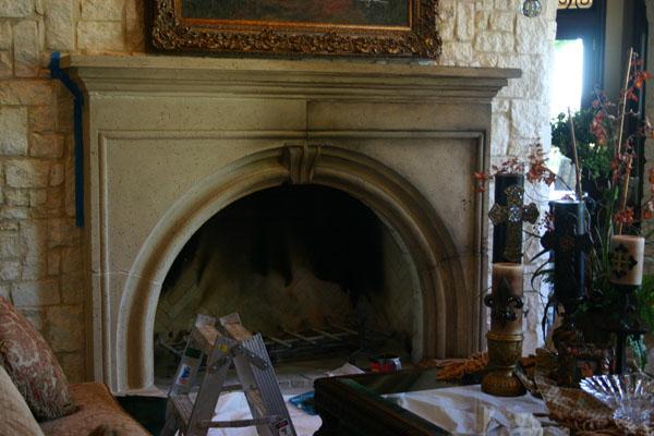 Finishing cast stone fireplace mantle.