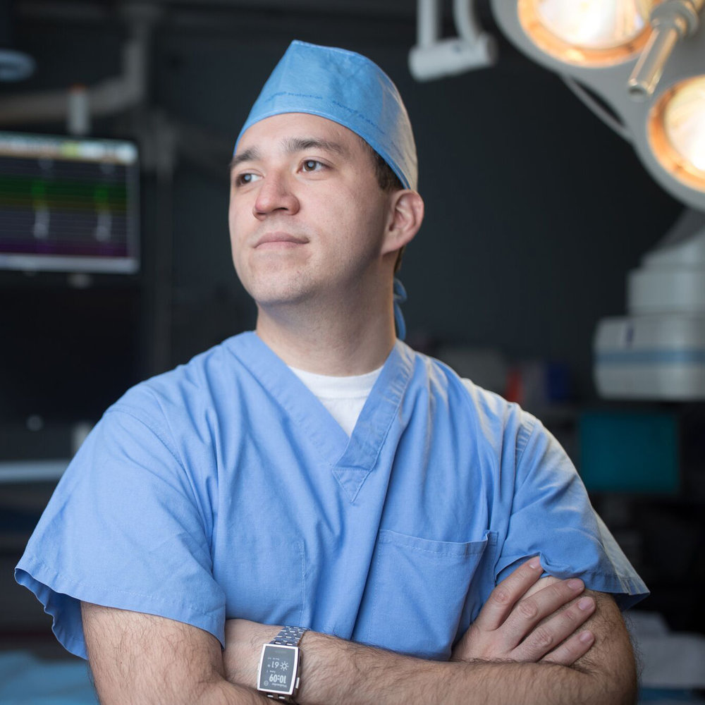 Portrait of heroic doctor in surgery room for healthcare