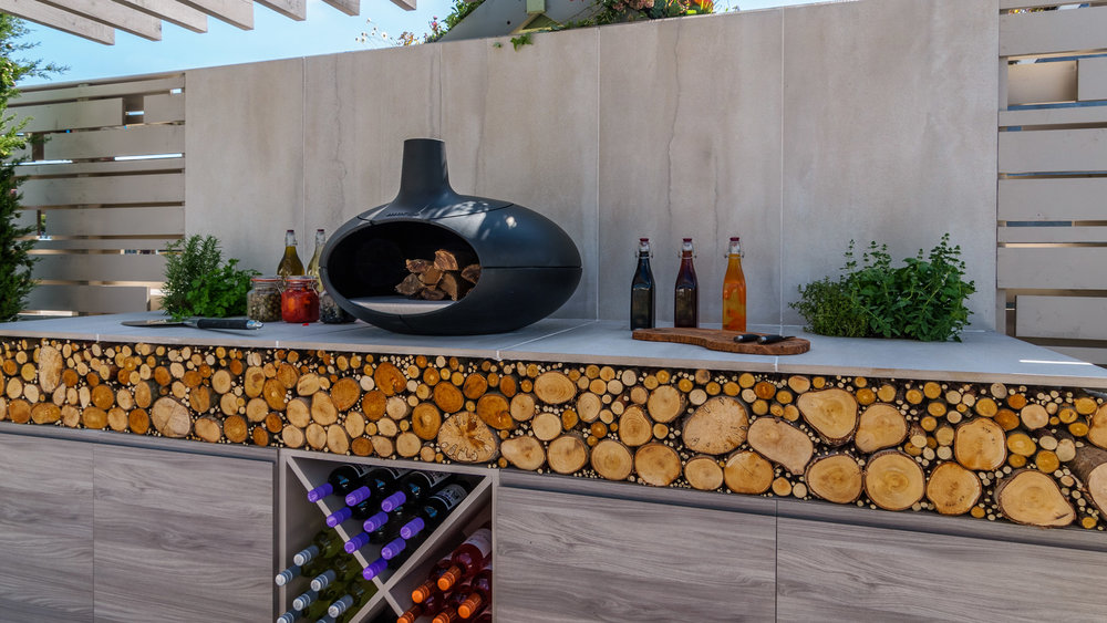 Southport Garden Design: A View Of The Olive Tree: Outdoor Kitchen With Morsø Oven, Log Store, Wine Rack And Herbs