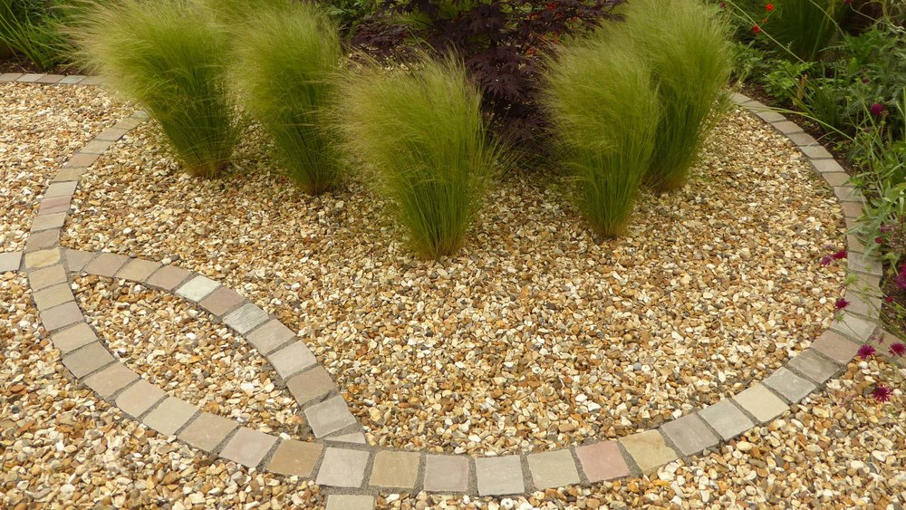 Cheshire Garden Design: Interlocking Curves and Acer (Front Garden) Grasses and gravel in a cobble circle