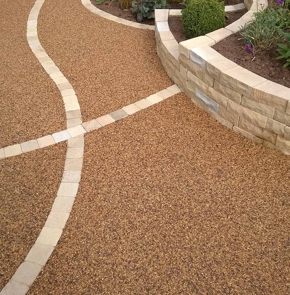 Resin bonded drive with York stone cobble feature.