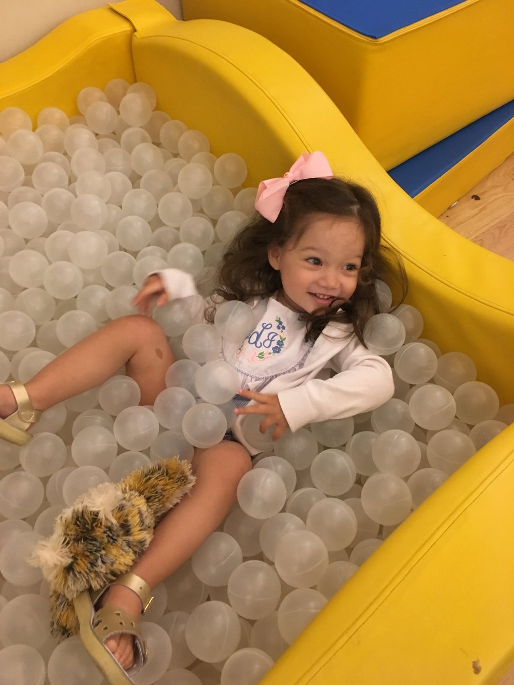 avvie in the ball pit at the hotel