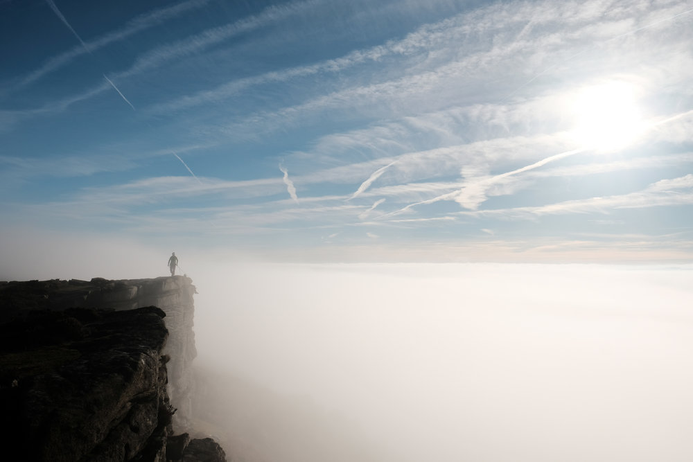 Climbers above the cloud in the Peak District, Derbyshire