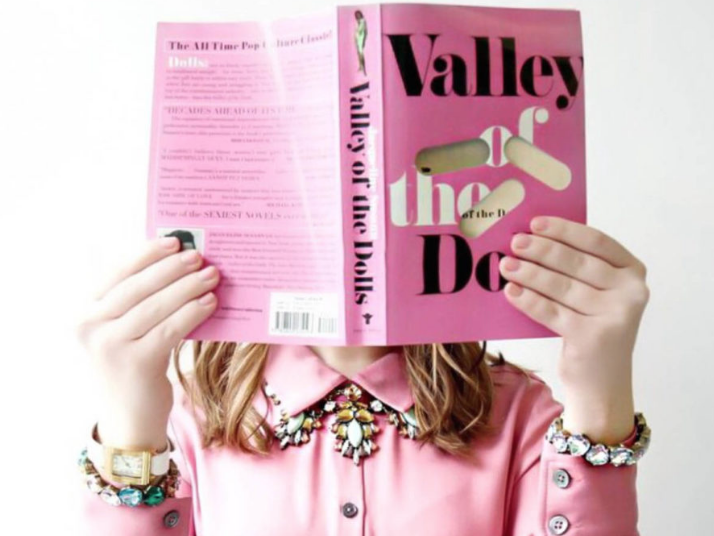 Suki: Valley of the Dolls by Jacqueline Susann -  This novel details the intersecting stories of three women, Neely O'Hara, Jennifer North, and Anne Welles, who strive for success and fame in New York City while navigating relationships and friendships in the cruel worlds of Hollywood and Broadway.A cautionary tale for anyone who has dreams of seeing their face on billboards or movie posters one day. This novel was like binge-eating a box of chocolates—you never know what you're going to get and you'll inevitably feel sick at the end, but you can't put it down.