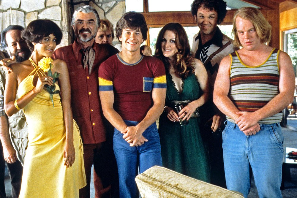 Lauren: Boogie Nights, dir. by Paul Thomas Anderson - Boogie Nights is set in LA's San Fernando Valley and focuses on a young nightclub dishwasher who becomes a popular porn star, chronicling his rise in the Golden Age of Porn of the 1970s through to his fall during the excesses of the 1980s. It's a classic. See Mark Wahlberg actually express emotion!