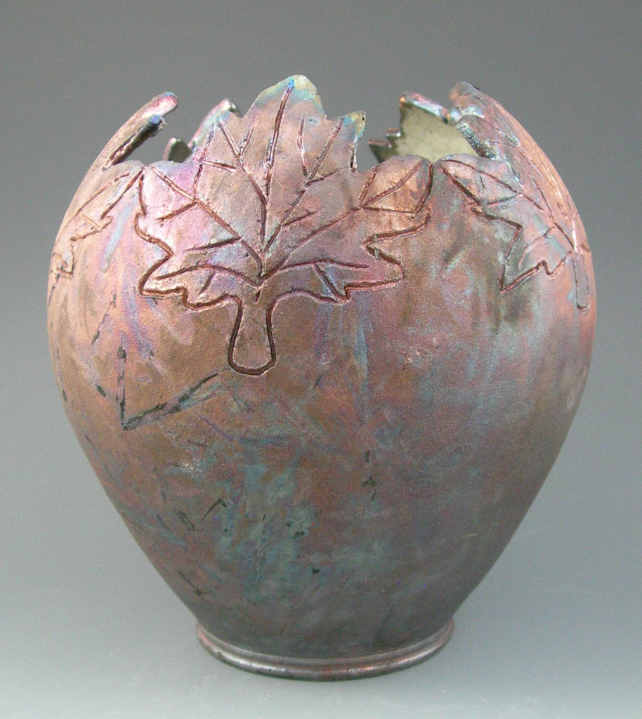 10 inch Raku fired vase with cur and carved rim, Gail Johnston.JPG