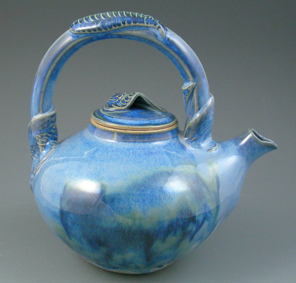8 inchstoneware  teapot, sprigged leaf additions, blue glazes, Gail Johnston.JPG