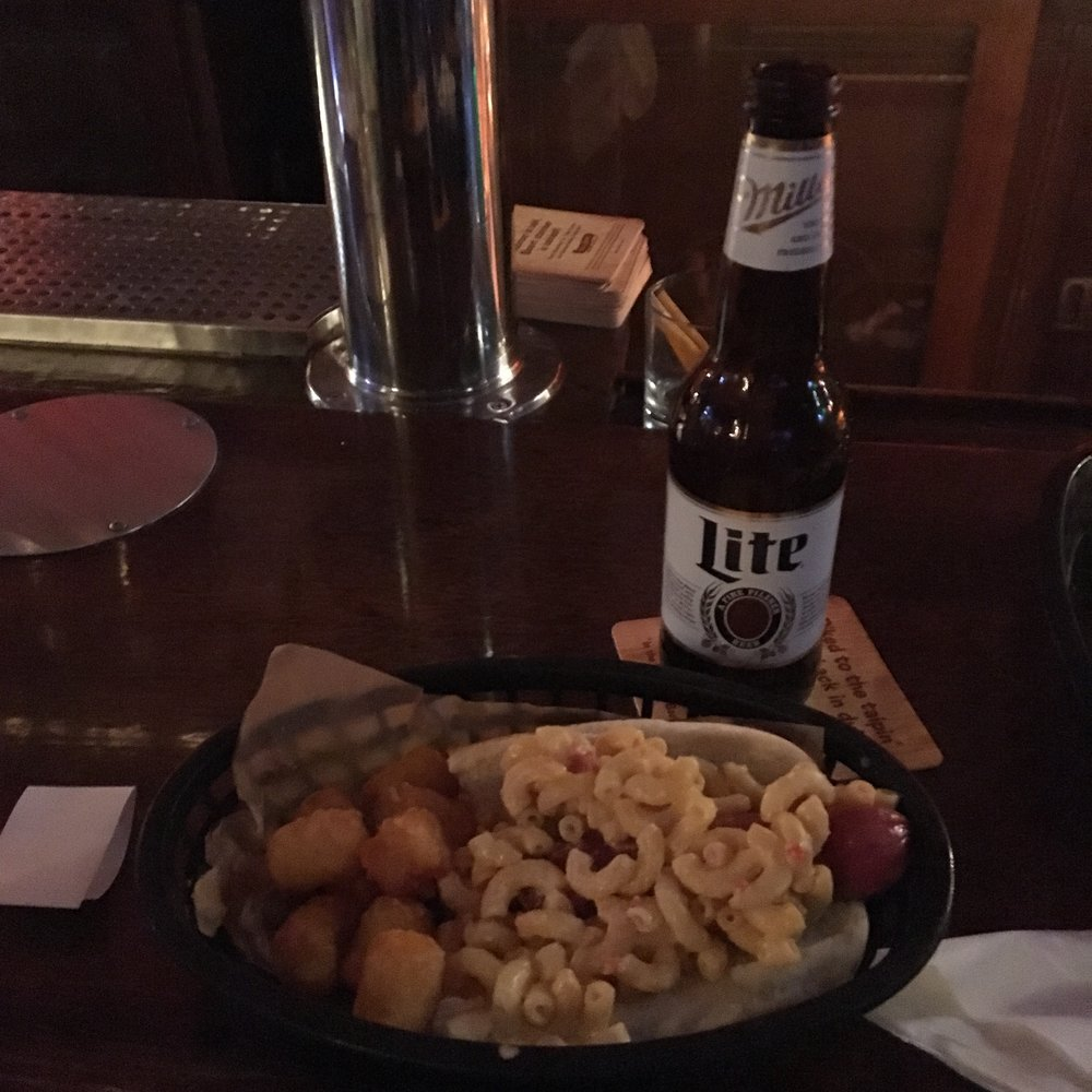 A hot dog slathered in mac & cheese in all its glory