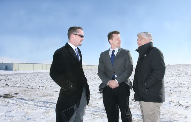 Conferring with City Administrator Scott Flory and Mayor Nelson Crabb of Clear Lake [L-R] at the site of what would become home to a 500,000 square foot, 210-job distribution center for McKesson Corporation, 2013.