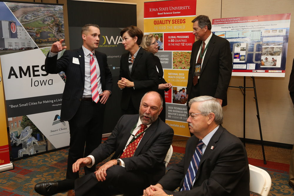 With Iowa Lt. Governor Kim Reynolds; Iowa State President Steven Leath and Iowa Governor Terry Branstad, L-R, foreground